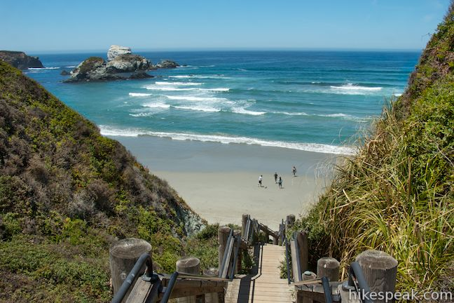 This stunning hike of half a mile or more reaches two scenic overlooks as it descends to a long beach on the Big Sur coast.