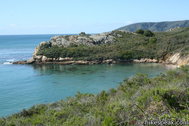 This 0.5-mile hike descends to a natural rock bridge at the end of a headland east of Avila Beach.