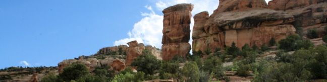 Devils Kitchen Trail is located near the south end of Colorado National Monument at the bottom of rugged No Thoroughfare Canyon. This 1.2-mile hike ascends 225 feet to visits an intriguing rock formation on the side of the canyon where tall boulders have enclosed a rock grotto