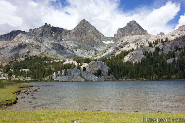 This hike of 14 miles or more crosses a scenic stretch of the Sierra through pine forests, lakes, meadows, and streams to reach a stunning backcountry lake below Mount Ritter and Banner Peak.