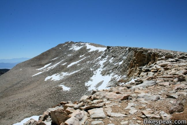 This 12,900-foot summit in the John Muir and Golden Trout Wildernesses can be reached via off-trail ascents from New Army Pass, Cirque Lake, and Chicken Spring Lake.