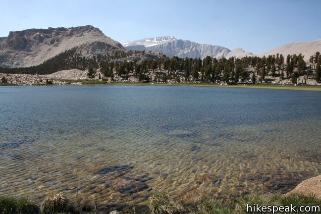 This 8 to 9-mile day hike follows a secluded trail through mountain meadows to the South Fork Lakes and Cirque Lake.
