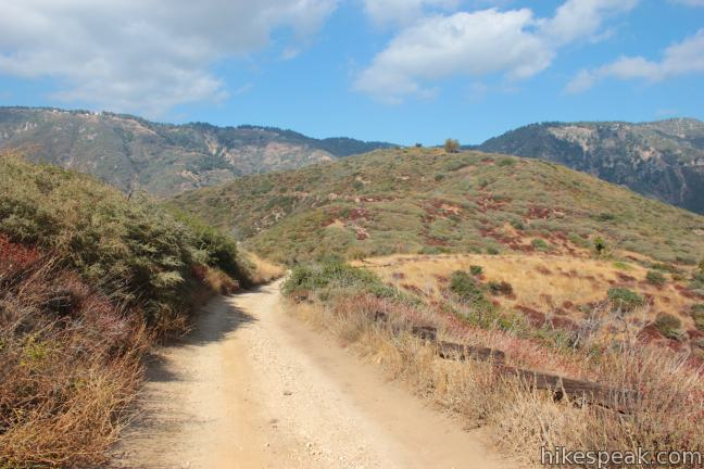 This 3.25-mile round trip hike reaches a panoramic summit above the foothills of the San Bernardino Mountains.
