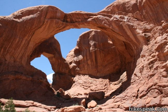 This 0.8-mile hike visits a pair of connected arches in the Windows region of Arches National Park.