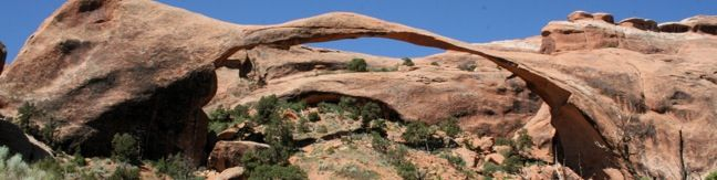Hiking Arches - The 290-foot long Landscape Arch is believed to be the longest natural rock span in the world.  The impressive sandstone arch can be reached via a level two-mile out and back hike in the Devils Garden region of Arches National Park near Moab, Utah