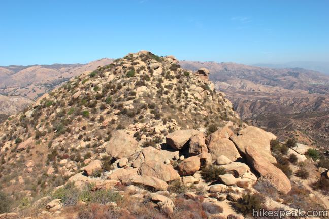 This 4.75-mile hike climbs to a summit in Rocky Peak Park in the Santa Susana Mountains on the border of Los Angeles and Ventura Counties with views over Chatsworth and Simi Valley.