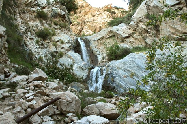 This double waterfall is a short distance up a rustic canyon with historical features.