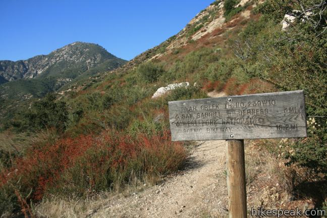 This 7-mile hike follows a gradual trail to a steep scramble to a 5,111 foot summit with panoramic views over the San Gabriel Mountains.
