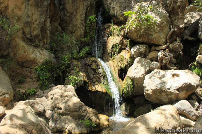 This easy and level 2.6-mile out and back hike visits the ruins of a burned down ranch and a small waterfall.